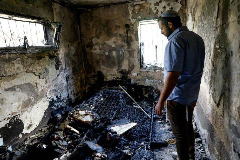An Israeli man among scattered debris on Sunday in his fire damaged home after the recent inter-communal violence between Arab and Jewish Israelis in the city of Lod near Tel Aviv