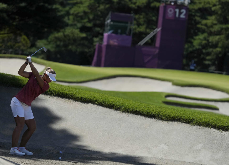 Emily Pedersen, of Denmark, plays a shot from a bunker on the 12th hole during the second round of the women's golf event at the 2020 Summer Olympics, Thursday, Aug. 5, 2021, at the Kasumigaseki Country Club in Kawagoe, Japan. (AP Photo/Andy Wong)