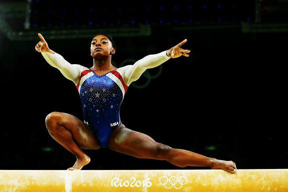 RIO DE JANEIRO, BRAZIL - AUGUST 11: Simone Biles of the United States competes on the balance beam during the Women's Individual All Around Final on Day 6 of the 2016 Rio Olympics at Rio Olympic Arena on August 11, 2016 in Rio de Janeiro, Brazil. (Photo by Alex Livesey/Getty Images)