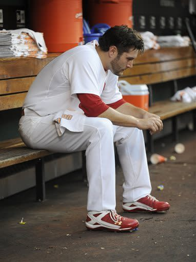 St. Louis Cardinals' starting pitcher Lance Lynn sits in the dugout against the New York Mets in the second inning in a baseball game Monday, May 13, 2013, at Busch Stadium in St. Louis. (AP Photo/Bill Boyce)