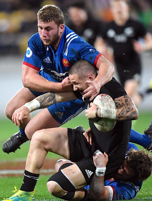 Rugby Union - June Internationals - New Zealand vs France - Westpac Stadium, Wellington, New Zealand - June 16, 2018 - TJ Perenara of New Zealand is tackled by Pierre Bourgarit of France. REUTERS/Ross Setford