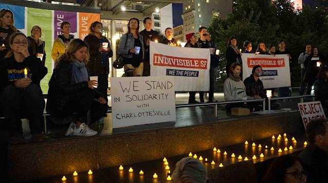 """<p>People take part in a candle light vigil in downtown San Francisco, the United States, on August 12, 2017. Three people were killed and 19 wounded in Charlottesville, as a supporter of the so-called alt-right movement rammed his car into a crowd of protesters against a white nationalist rally. Then, a local group known as Indivisible SF, short for San Francisco, called for the vigil """"to stand in solidarity with Charlottesville."""" (Xu Yong/Xinhua via ZUMA Wire) </p>"""