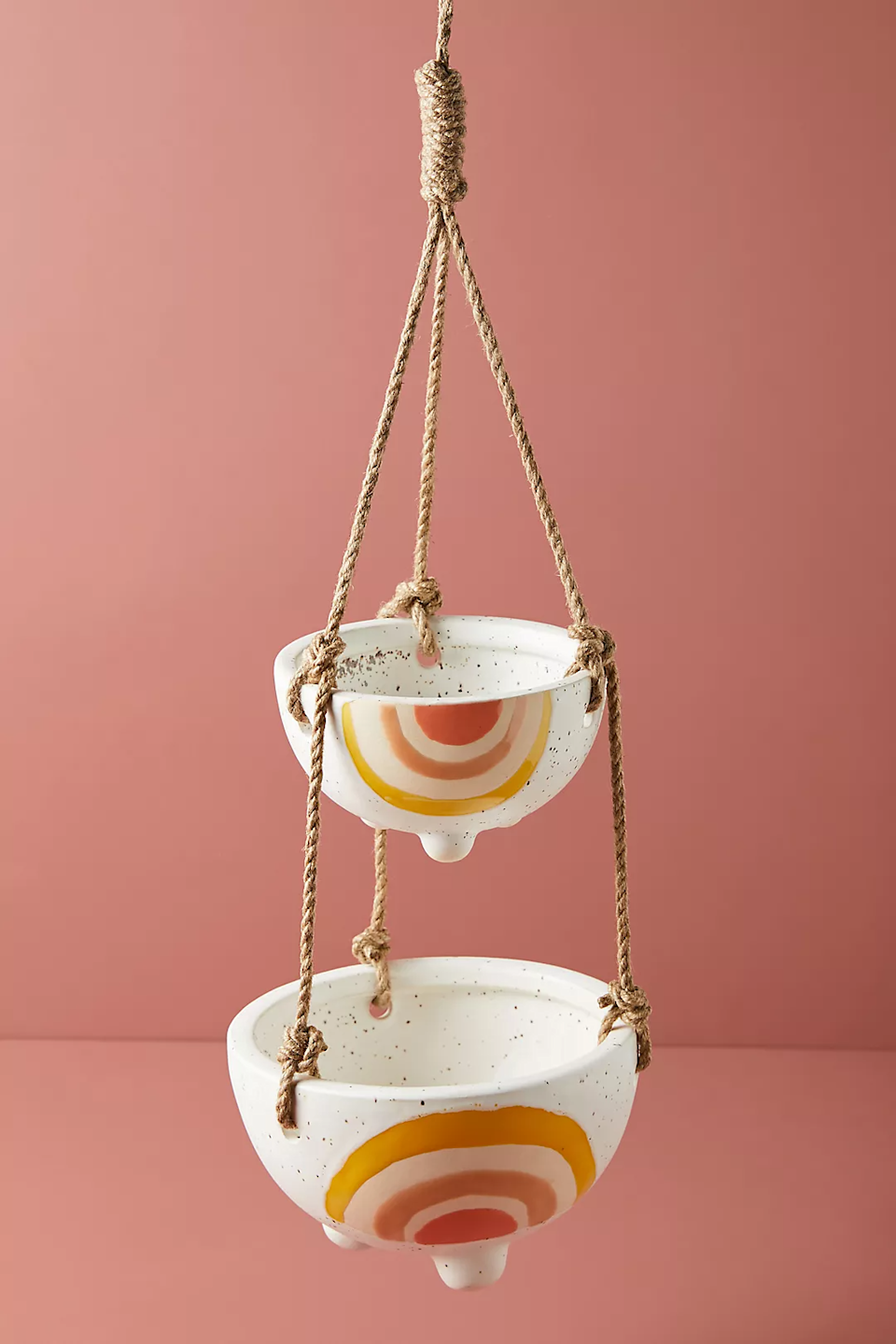 """<h2>Anthropologie Iris Rainbow Two-Tier Hanging Planter</h2><br>If this sweet little rainbow duo doesn't brighten up a dark corner of your space, we're not sure what will.<br><br><strong>Anthropologie</strong> Iris Rainbow Two-Tier Hanging Planter, $, available at <a href=""""https://go.skimresources.com/?id=30283X879131&url=https%3A%2F%2Fwww.anthropologie.com%2Fshop%2Firis-rainbow-two-tier-hanging-planter"""" rel=""""nofollow noopener"""" target=""""_blank"""" data-ylk=""""slk:Anthropologie"""" class=""""link rapid-noclick-resp"""">Anthropologie</a>"""