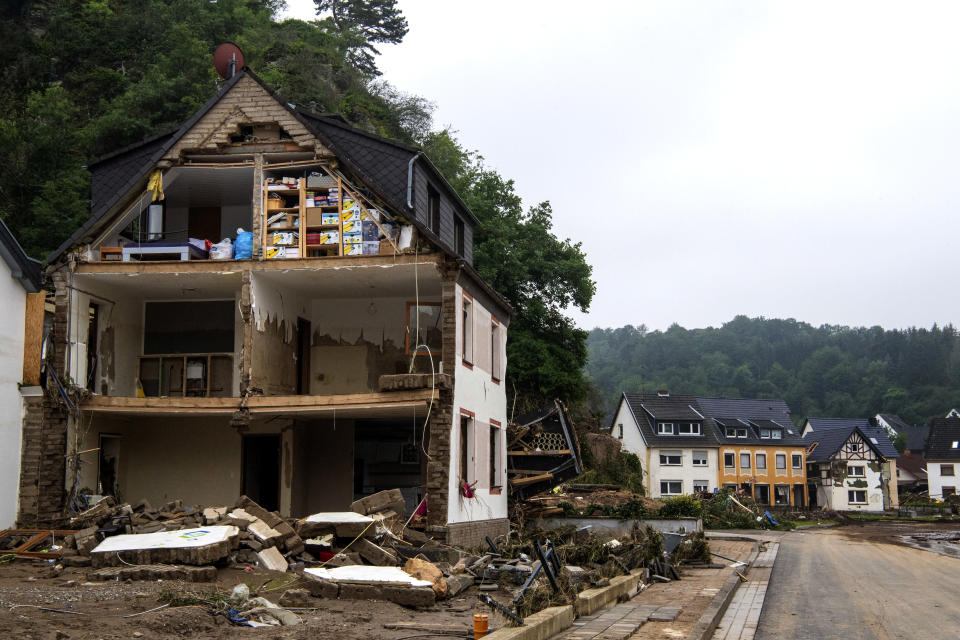 A distroyed house is seen in Altenahr, western Germany, Saturday, July 17, 2021. Heavy rains caused mudslides and flooding in the western part of Germany. Multiple have died and are missing as severe flooding in Germany and Belgium turned streams and streets into raging, debris-filled torrents that swept away cars and toppled houses. (Lino Mirgeler/dpa via AP)