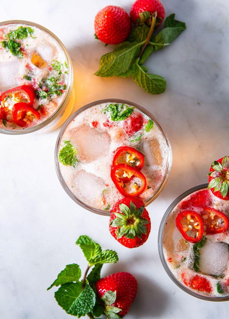 """<p>These have a real punch of heat.</p><p>Get the recipe from <a href=""""https://www.delish.com/cooking/recipe-ideas/a32783504/strawberry-mint-julep-recipe/"""" rel=""""nofollow noopener"""" target=""""_blank"""" data-ylk=""""slk:Delish"""" class=""""link rapid-noclick-resp"""">Delish</a>. </p>"""