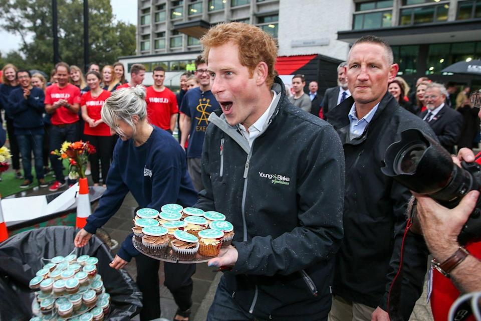 <p>While these are technically cupcakes rather than a full cake, Prince Harry looks thrilled, nonetheless. </p>