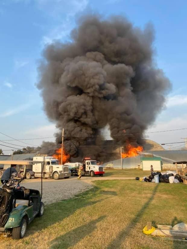The fire reportedly started late Saturday afternoon and was contained around 10:30 p.m. CST with the help of three farmers. (Gloria Yasenko Gingera - image credit)