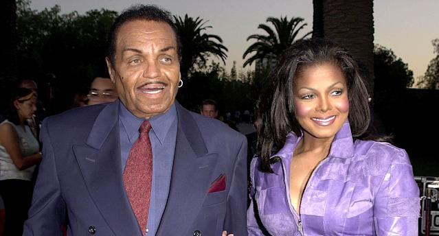 Janet Jackson with her father, Joe Jackson, at the premiere of <em>Nutty Professor II</em> in 2000. (Photo: Lucy Nicholson/AFP/Getty Images)