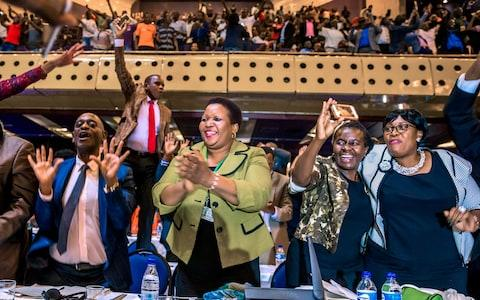 Parliament erupts after the announcement  - Credit: JEKESAI NJIKIZANA/AFP