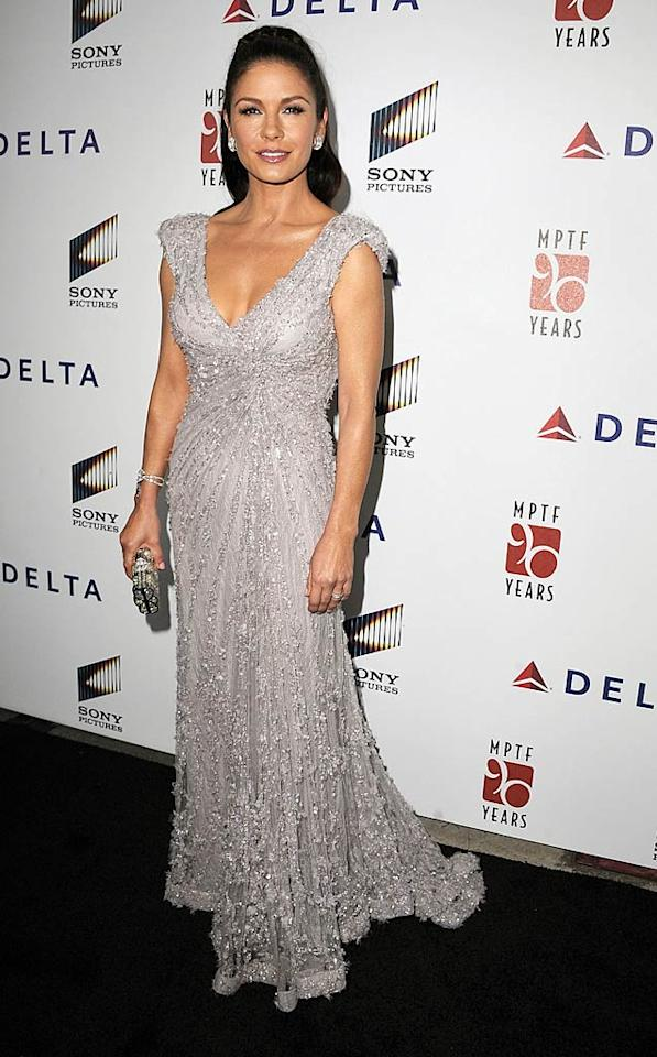 "Catherine Zeta-Jones was the epitome of elegance at Sony's 6th Annual ""A Fine Romance"" event. The screen siren sported diamond baubles and an intricate Elie Saab stunner that hugged her curves in all the right places. (10/15/11)"