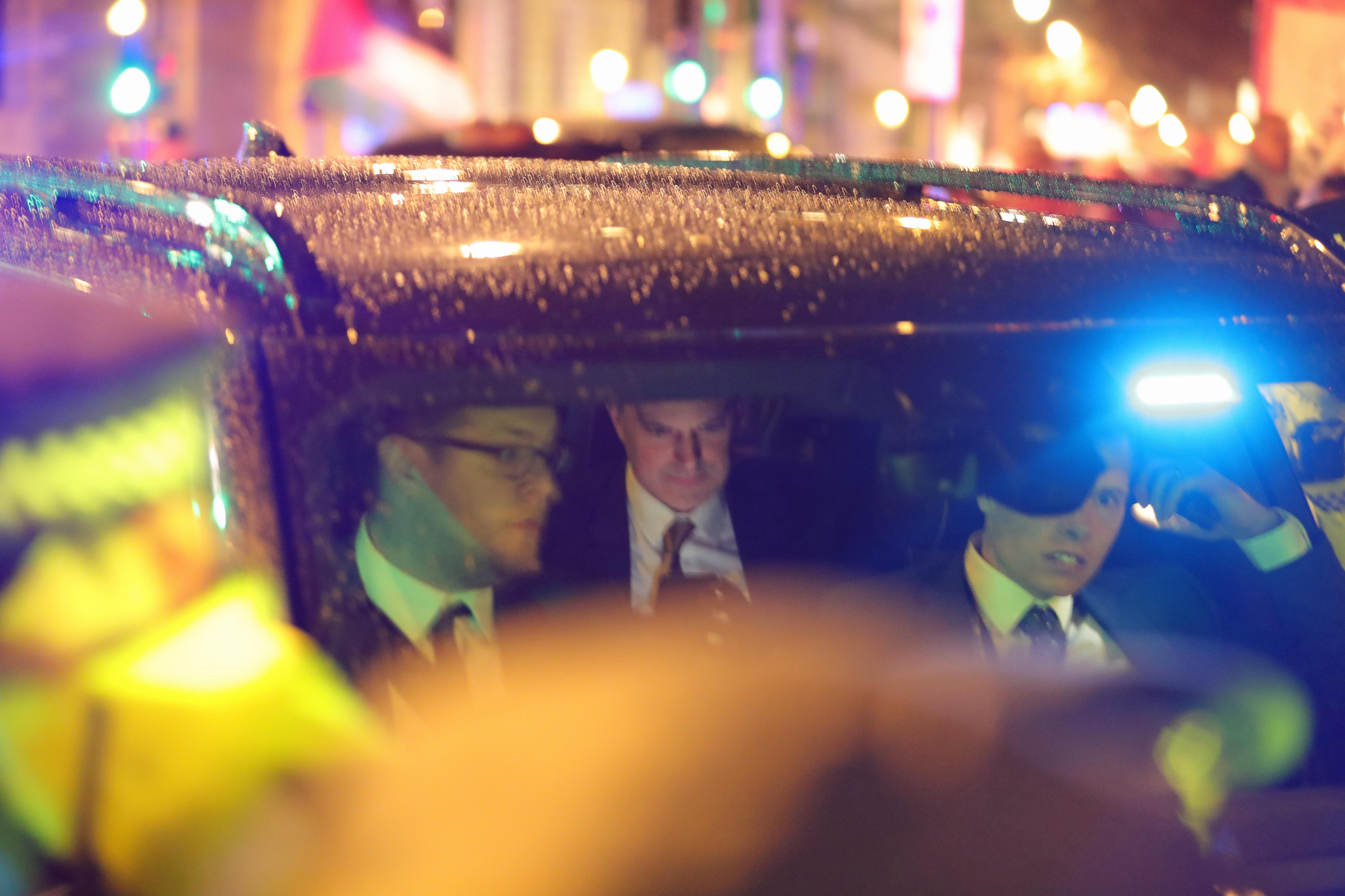 Protesters obstruct Northern Ireland Secretary Julian Smith in a minsterial car as he leaves the Houses of Parliament in London, as their protest against government plans to deport 50 people to Jamaica continues.