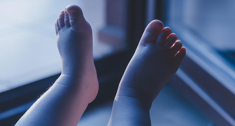 A stock image of baby's feet. A New Mexico mum has been arrested after a newborn's body was found in a rubbish bag.