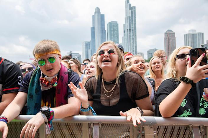 Thousands of concertgoers gather at Lollapalooza in Grant Park, Chicago (AP)