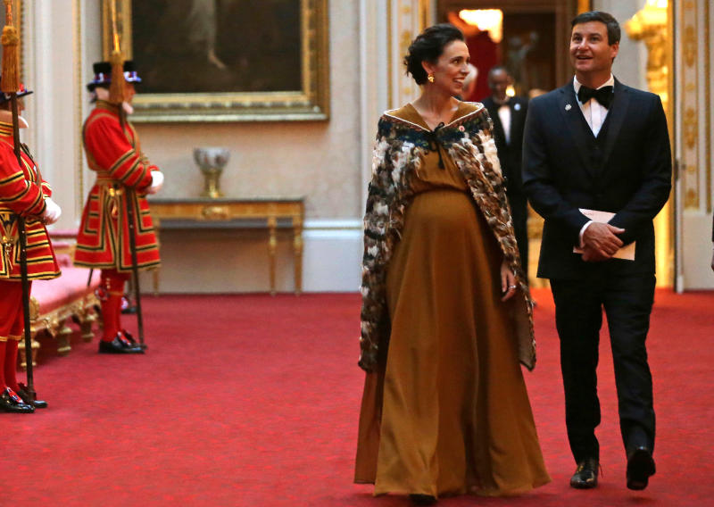 New Zealand leader triumphs abroad, faces pressures at home