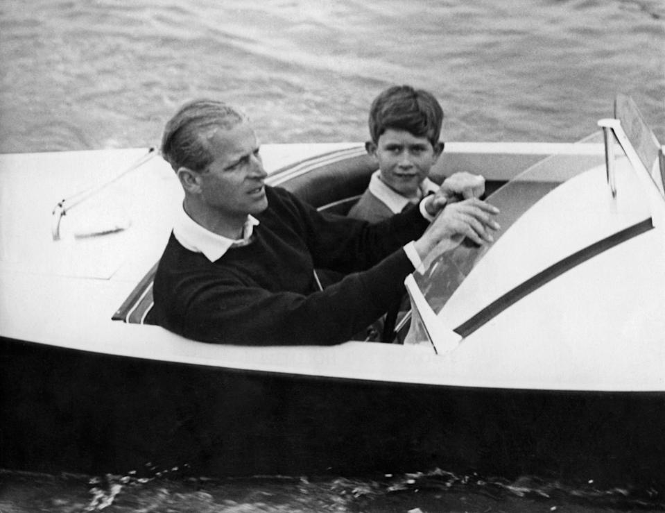 Prince Charles of Wales with his father Prince Philip of Edinburgh on board a boat, 1955AFP via Getty Images