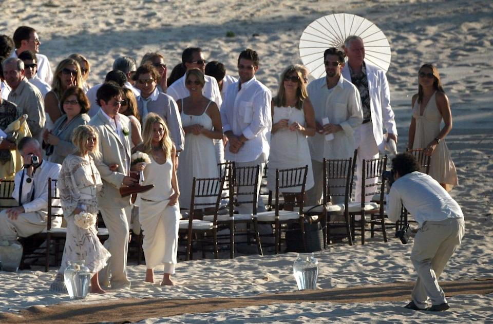 <p>The stylish twins walked down the aisle in bohemian-inspired white dresses for a friend's wedding back in 2007. <i>(Splash News)</i></p>