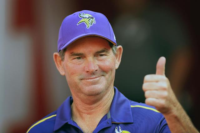 FILE - In this Aug. 23, 2014, file photo, Minnesota Vikings head coach Mike Zimmer displays a thumbs-up before an NFL preseason football game against the Kansas City Chiefs in Kansas City, Mo. The biggest questions to answer have been on defense, where new coach Zimmer has been busy trying to improve a unit that struggled badly last year. (AP Photo/Ed Zurga, File)