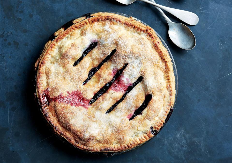"""The filling for this blueberry pie with ginger will be loose when it comes out of the oven, but as long as you let it rest for the full 4 hours, it will firm beautifully. <a href=""""https://www.bonappetit.com/recipe/blueberry-ginger-double-crust-pie?mbid=synd_yahoo_rss"""" rel=""""nofollow noopener"""" target=""""_blank"""" data-ylk=""""slk:See recipe."""" class=""""link rapid-noclick-resp"""">See recipe.</a>"""
