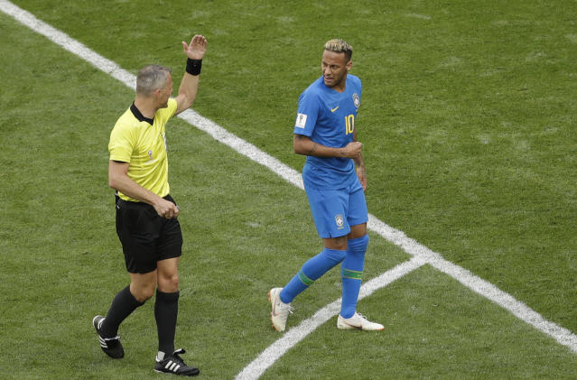 Brazil's Neymar, right, looks at referee Bjorn Kuipers from Netherlands during the group E match between Brazil and Costa Rica at the 2018 soccer World Cup in the St. Petersburg Stadium in St. Petersburg, Russia, Friday, June 22, 2018. (AP Photo/Michael Sohn)