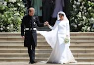 <p>Harry and Meghan stepped out of the chapel as husband and wife, after a whirlwind courtship. (Jane Barlow/AFP)</p>