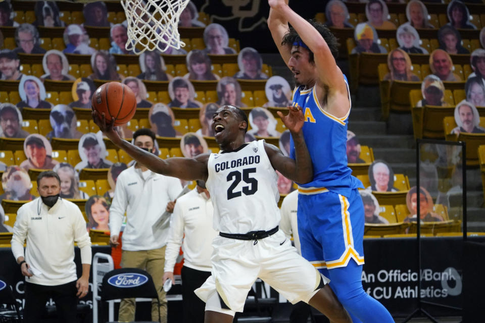 Colorado guard McKinley Wright IV looks for a shot as UCLA guard Jaime Jaquez Jr. defends during the second half of an NCAA college basketball game Saturday, Feb. 27, 2021, in Boulder, Colo. (AP Photo/David Zalubowski)