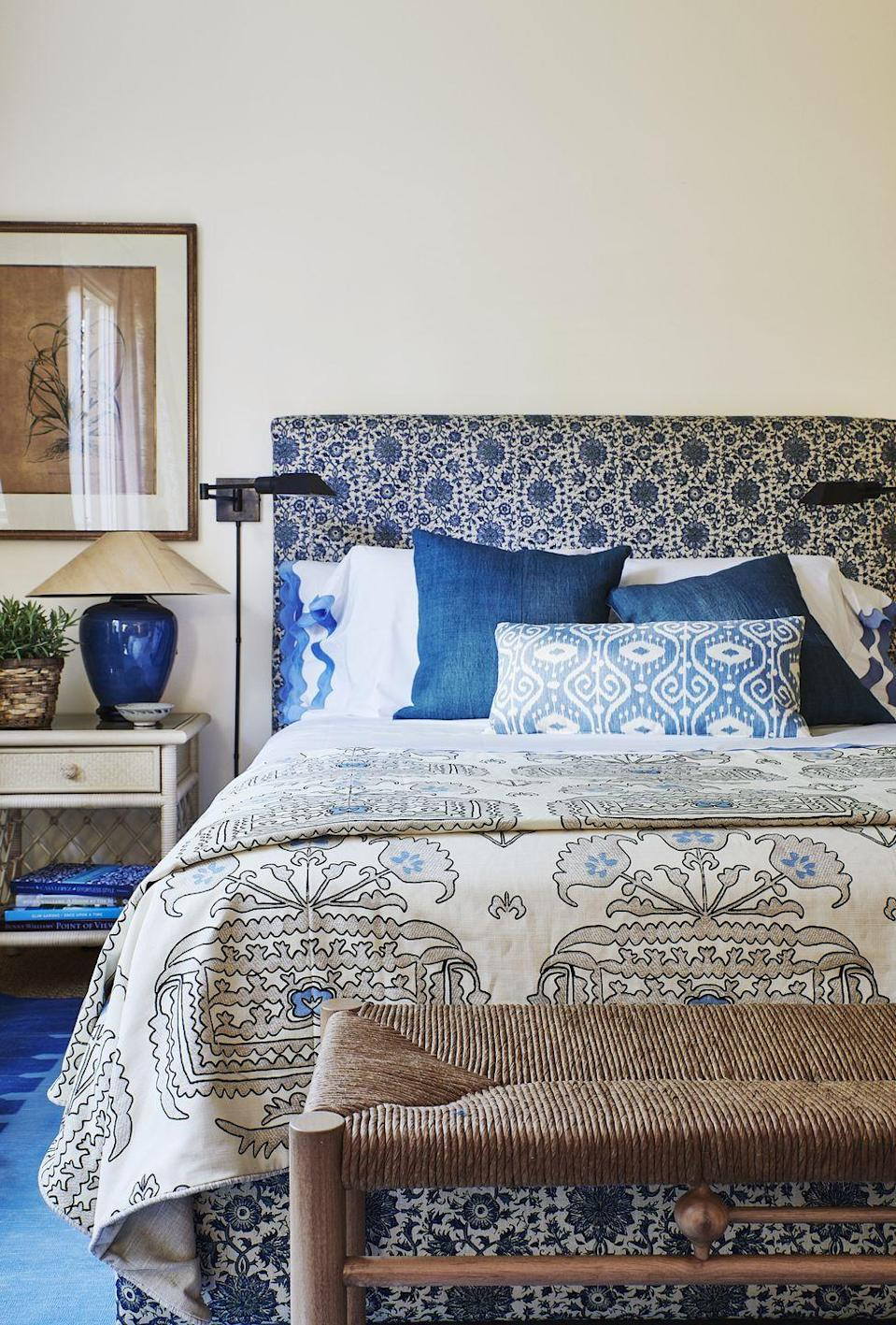 "<p>This well-collected guest bedroom in <a href=""https://www.veranda.com/decorating-ideas/house-tours/a34244492/mark-sikes-california-house-tour-2020/"" rel=""nofollow noopener"" target=""_blank"" data-ylk=""slk:fashion designer Karen Kane's Pacific Palisades manse"" class=""link rapid-noclick-resp"">fashion designer Karen Kane's Pacific Palisades manse</a> features ultra-sleek, utilitarian sconces that act as a modern foil to the globally inspired patterns and textures throughout the room. An extra bedside lamp ensures a brighter glow can be achieved when desired. </p>"