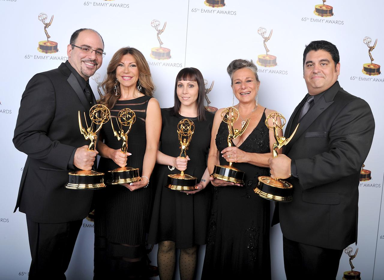 From left, Louie Zakarian, Daniela Zivkovic, Amy Tagliamonti, Melanie Demetri, and Josh Turi pose for a portrait at the 2013 Primetime Creative Arts Emmy Awards, on Sunday, September 15, 2013 at Nokia Theatre L.A. Live, in Los Angeles, Calif. (Photo by Vince Bucci/Invision for Academy of Television Arts & Sciences/AP Images)