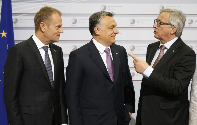 FILE - In this May 22, 2015 file photo, European Commission President Jean-Claude Juncker, right, and European Council President Donald Tusk, left, greet Hungary's Prime Minister Viktor Orban during a summit in Riga, Latvia. As the Hungarian prime minister's conflicts with the European Union appear headed to a breaking point, calls are increasing for greater scrutiny of his government's spending of EU funds. An opposition lawmaker in Hungary has gathered over 470,000 signatures to pressure Prime Minister Viktor Orban into joining the budding European Public Prosecutor's Office as Orban's Fidesz party may be suspended or expelled next week from the main center-right group in the European Parliament, it was announced Thursday, March 14, 2019 (AP Photo/Mindaugas Kulbis, File)