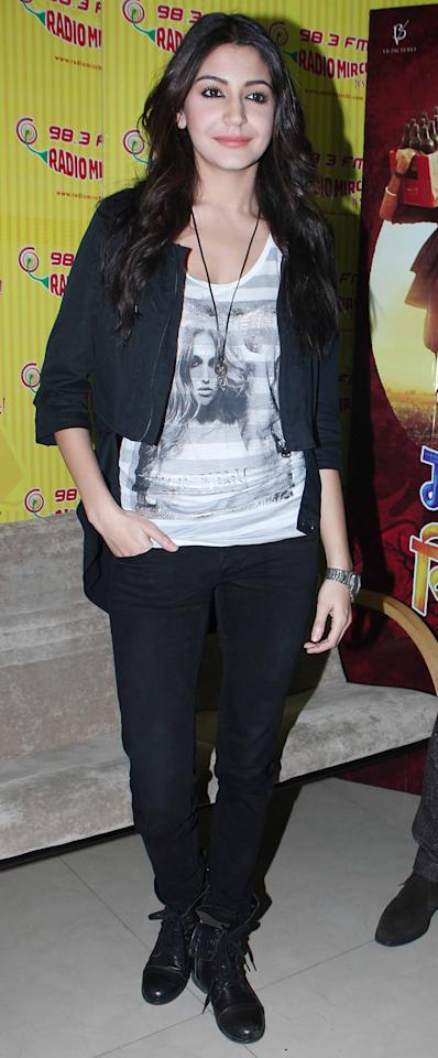 Wild child Anushka Sharma keeps it simple yet stylish. We love the girly touch of the matt coloured lips.