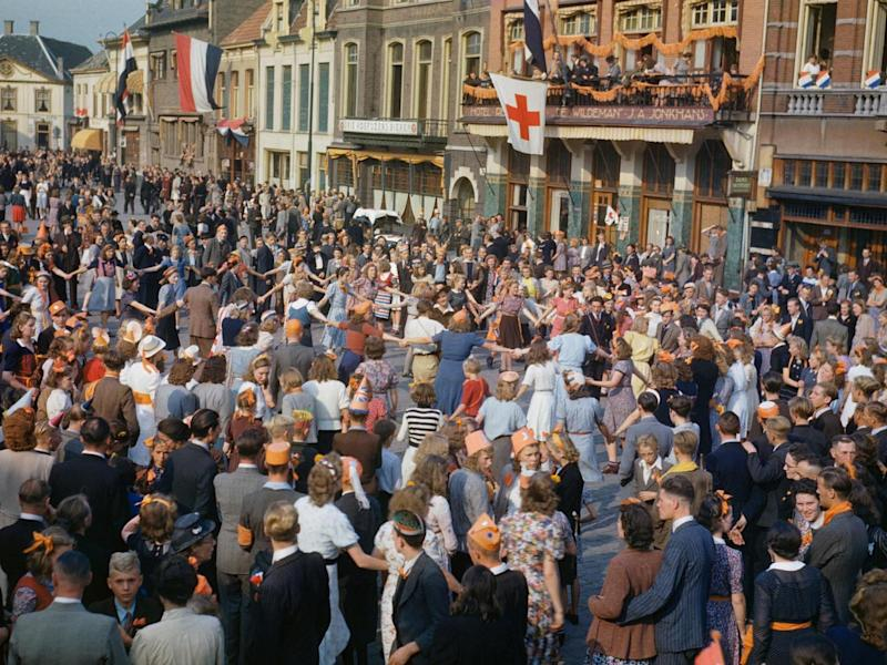 Dutch civilians dancing in the streets after the liberation of Eindhoven by Allied forces, September 1944 (Imperial War Museum )