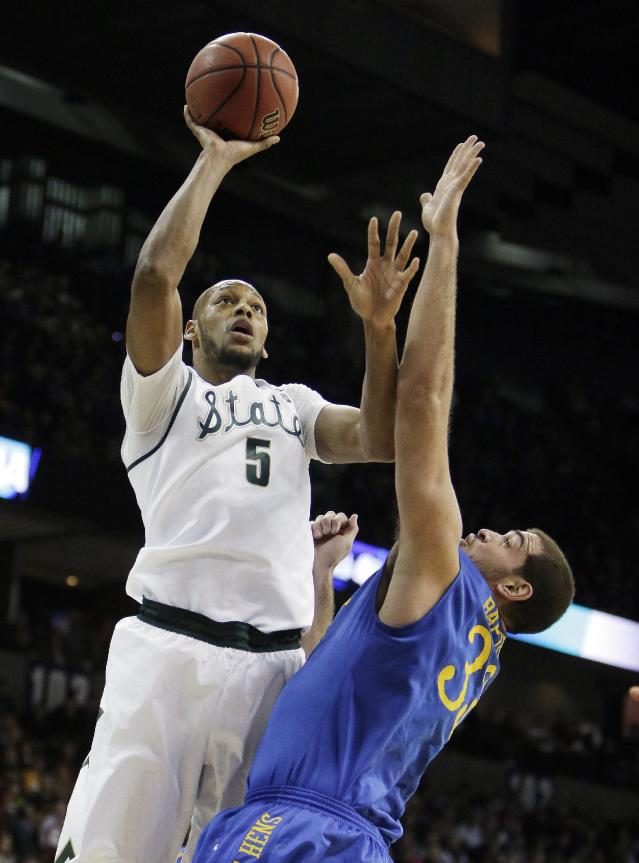 Michigan State's Adreian Payne (5) shoots over Delaware's Carl Baptiste (33) in the first half during the second-round of the NCAA men's college basketball tournament in Spokane, Wash., Thursday, March 20, 2014. (AP Photo/Young Kwak)