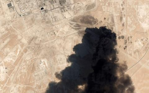 <span>Thick black smoke rising from Saudi Aramco's Abqaiq oil processing facility in Buqyaq</span> <span>Credit: Planet Labs Inc </span>