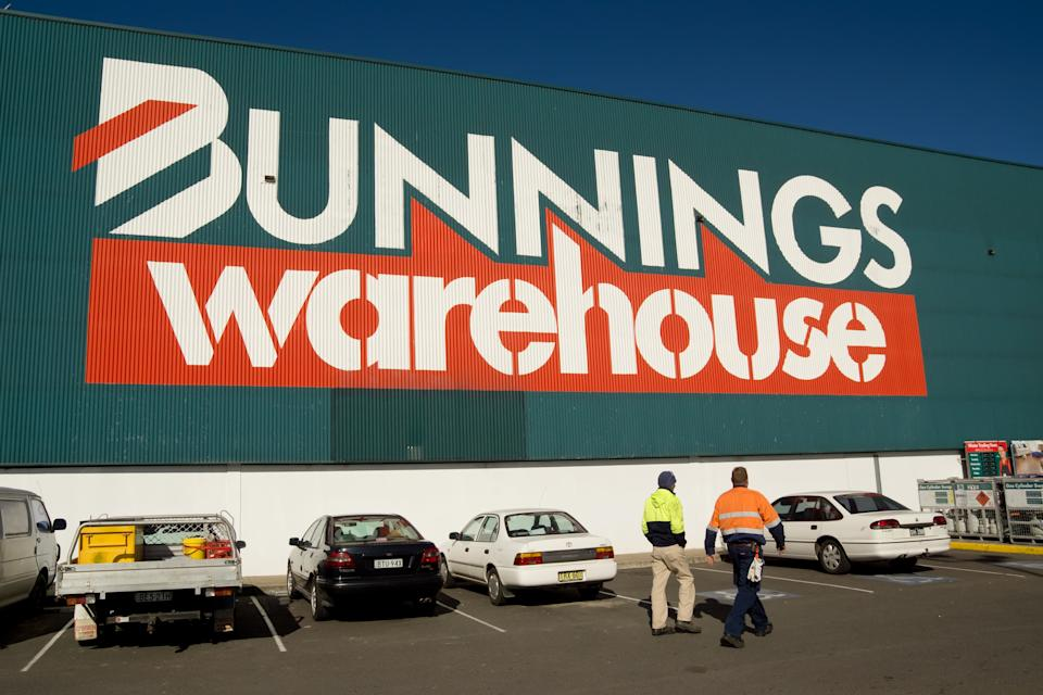 Two tradesmen walk toward the entrance of a Bunnings Warehouse. Source: Getty Images