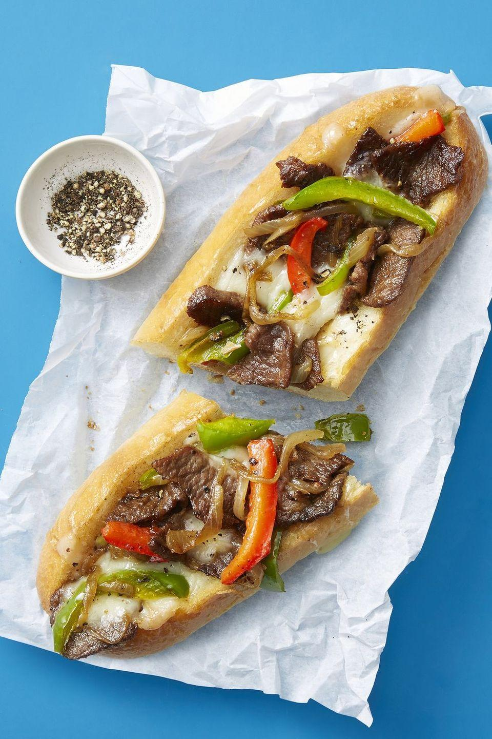 """<p>Who said sandwiches are only good for lunch? This stuffed sub feels like the best of both worlds; a medley of flavors and something fast you can eat with your hands! <br></p><p><em><a href=""""https://www.goodhousekeeping.com/food-recipes/easy/a48190/philly-cheesesteak-recipe/"""" rel=""""nofollow noopener"""" target=""""_blank"""" data-ylk=""""slk:Get the recipe for Philly Cheesesteaks »"""" class=""""link rapid-noclick-resp"""">Get the recipe for Philly Cheesesteaks »</a></em></p>"""