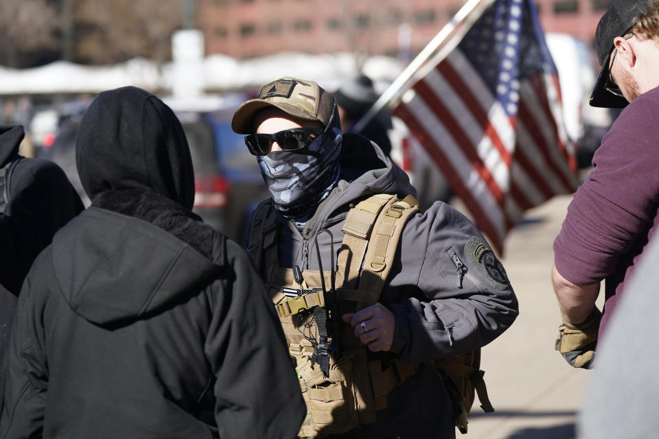 Protesters square off in a verbal battle during a rally in support of President Donald Trump, Wednesday, Jan. 6, 2021, outside the State Capitol in downtown Denver. (AP Photo/David Zalubowski)