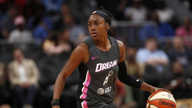 Atlanta Dream guard Tiffany Hayes (15) looks to pass in the first half of a WNBA basketball game against the Chicago Sky Tuesday, Aug. 20, 2019, in Atlanta. (AP Photo/John Bazemore)