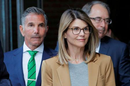 FILE PHOTO: Actor Lori Loughlin and her husband Mossimo Giannulli leave the federal courthouse in Boston