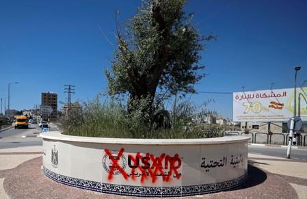 FILE PHOTO: Crossed out logo of USAID is seen in Ramallah, in the Israeli-occupied West Bank