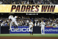 San Diego Padres celebrate after the Padres beat the Los Angeles Dodgers 5-3 in a baseball game Wednesday, June 23, 2021, in San Diego. (AP Photo/Denis Poroy)