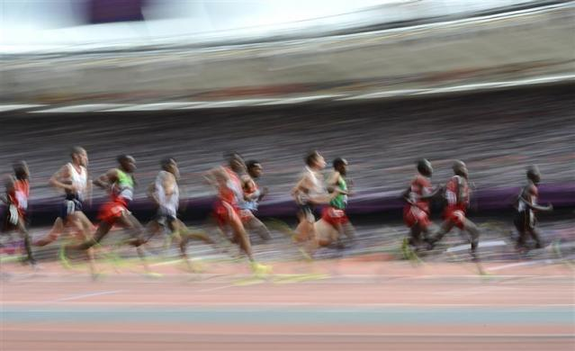 Athletes compete in the men's 5000m round 1 heat during the London 2012 Olympic Games at the Olympic Stadium August 8, 2012.