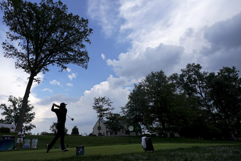 Jon Rahm, of Spain, tees off from the tenth hole during the second round of the BMW Championship golf tournament, Friday, Aug. 27, 2021, at Caves Valley Golf Club in Owings Mills, Md. (AP Photo/Julio Cortez)