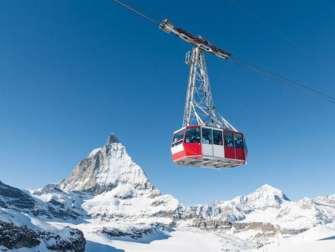 Zermatt would be an excellent choice and, since it is linked to Cervinia, it gives you the option of skiing down into Italy for lunch - Credit: GETTY