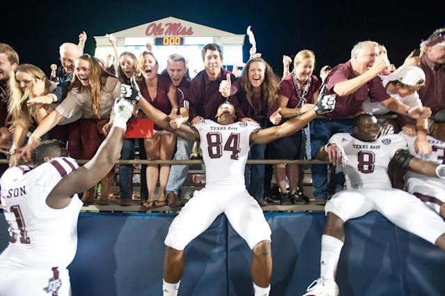 OXFORD, MS - OCTOBER 12: Texas A&M players celebrate after defeating Ole Miss on October 12, 2013 at Vaught-Hemingway Stadium in Oxford, Mississippi. Texas A&M defeated Ole Miss 41-38. (Photo by Michael Chang/Getty Images)