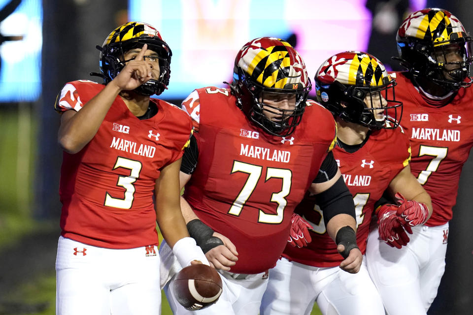 Maryland quarterback Taulia Tagovailoa, far left, reacts after scoring a touchdown on a run against Minnesota during the first half of an NCAA college football game, Friday, Oct. 30, 2020, in College Park, Md. (AP Photo/Julio Cortez)