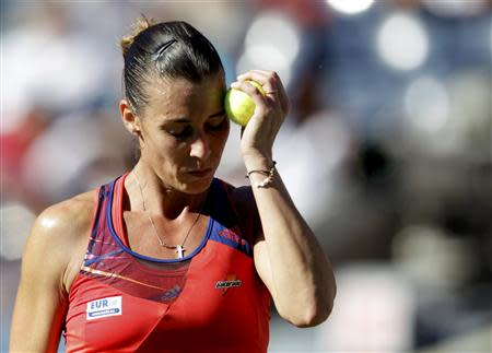 Pennetta of Italy reacts to a missed point against Azarenka of Belarus at the U.S. Open tennis championships in New York