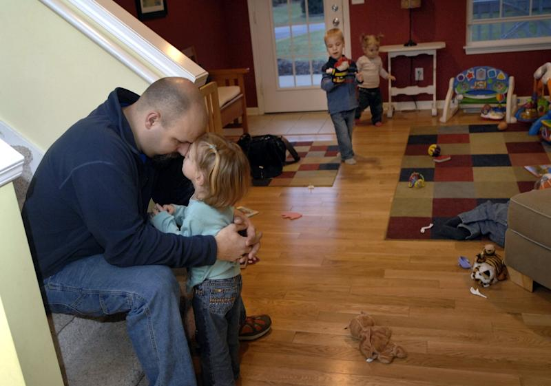 Ben Van Houten talks with his daughter Sammy at their home in Hamilton, Mich. A relative says Ben Van Houten suffered a fatel heart attack Wednesday night, April 9, 2014, after setting up a trampoline at his home in the Holland-area in western Michigan. The father of Michigan's first surviving set of sextuplets was 39. (AP Photo/The Grand Rapids Press, Katy Batdorff) ALL LOCAL TV OUT; LOCAL TV INTERNET OUT