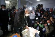 Actor and singer Kikabidze, who is at the top of the United National Movement party's electoral list, visits a polling station during a parliamentary election in Tbilisi
