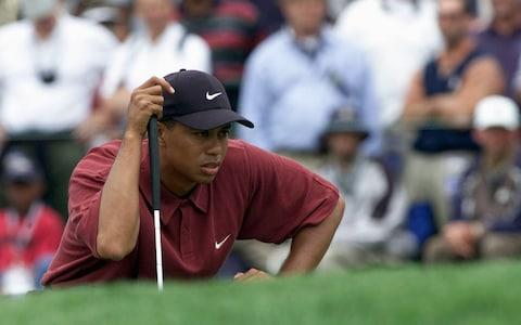 Tiger Woods lines up a putt on the first green during the final round of the 100th US Open - Credit: Getty Images