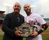 Sixteen-time World Professional wrestler Ric Flair, now working for Total Nonstop Action Wrestling (TNA) met up with Boston Red Sox second baseman Dustin Pedroia (#15), a huge fan, prior to the start of tonight's game against the Baltimore Orioles. The Boston Red Sox took on the Baltimore Orioles in Game 3 of a 4 game series at Fenway Park. (Photo by Barry Chin/The Boston Globe via Getty Images)