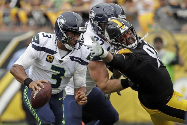 Seahawks' Carroll gushes about improved, quick-passing Wilson